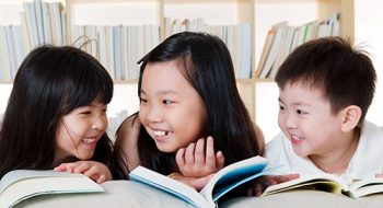 Asian kids reading